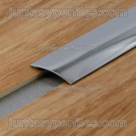 Tapajunta de acero inoxidable sobrepuesto con adhesivo